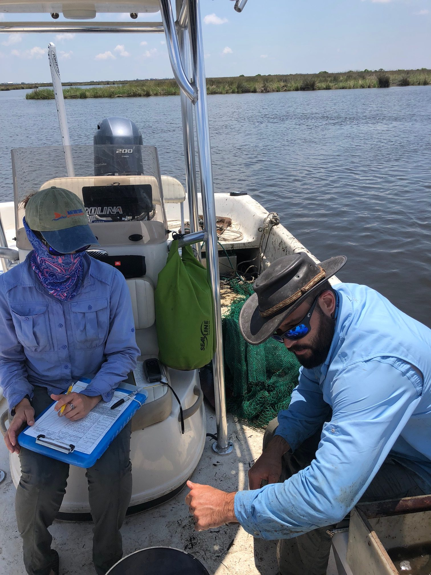 UF researchers take data of species abundance, length, and biomass on a recent sampling trip. Photo credit: C. Martin